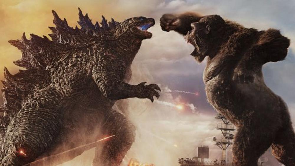 Godzilla monster fighting King Kong