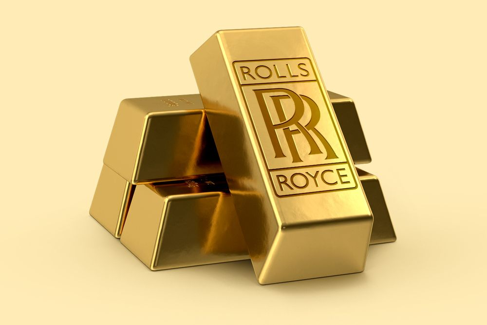 Four bars of gold with Rolls-Royce logo on one