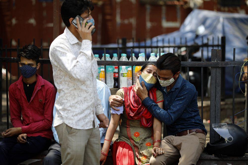 NEW DELHI, INDIA - APRIL 21: Relatives of a COVID-19 victim react outsid...