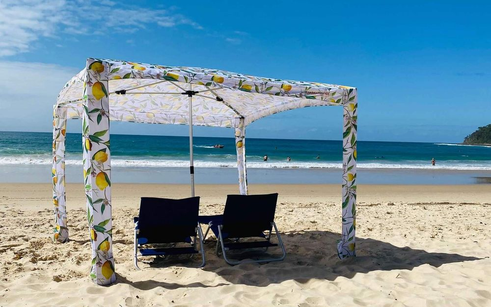 CoolCabana on beach with two beach chairs underneath