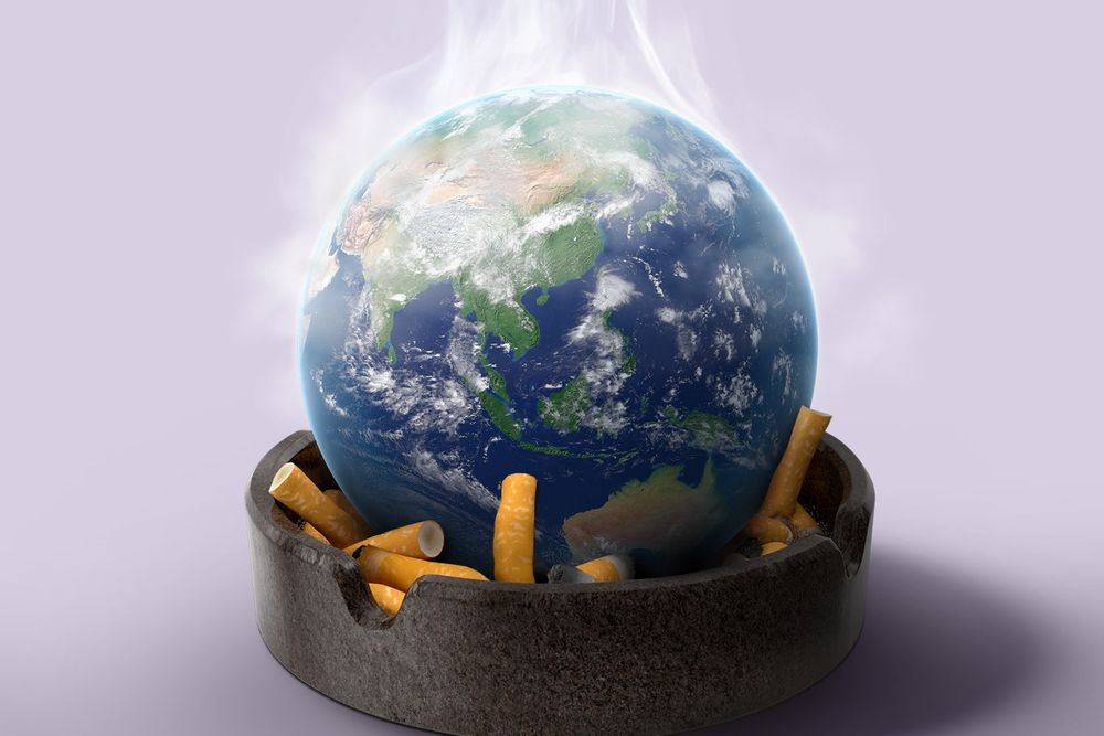 An illustration of the planet Earth sitting on top of crumpled cigarettes in a grey ashtray. Smoke fumes are rising off the top of the Earth.