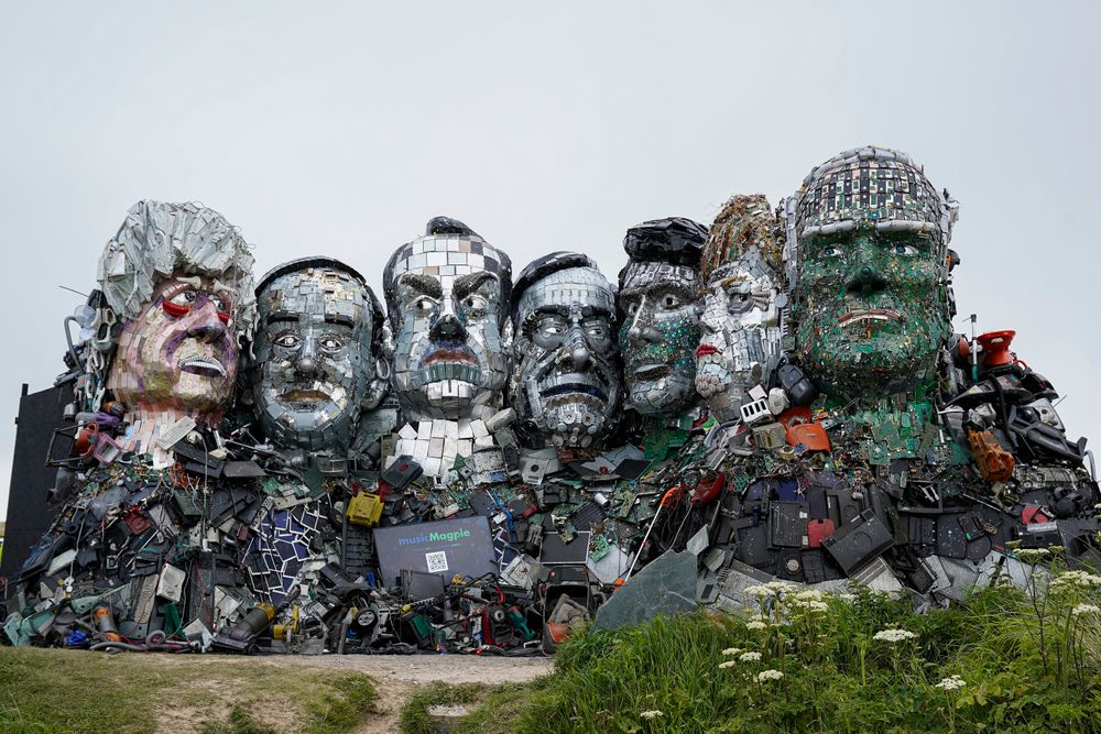 Mount Recyclemore, the giant sculpture of Boris Johnson, Joe Biden and fellow G7 leaders made from discarded electronics components in situ on a clifftop near Carbis Bay, on June 09, 2021 in St Ives, England. The sculpture, created by musicMagpie in partnership with artist Joe Rush alongside sculptor Alex Wreckage, aims to highlight the growing threat of e-waste on the planet.