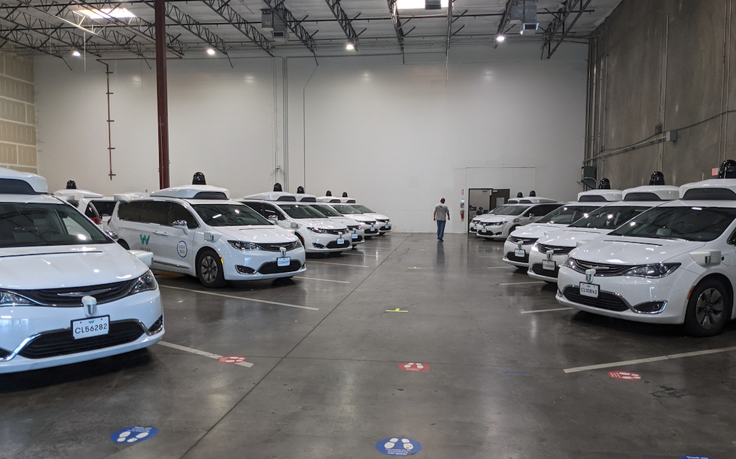 Waymo depot near Chandler, Arizona. Rows of Waymo's Chrysler Pacificas rest in their home