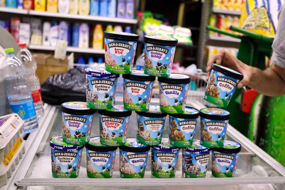 A man buys Ben & Jerry's ice cream in Jerusalem on July 20, 2021. - Amer...