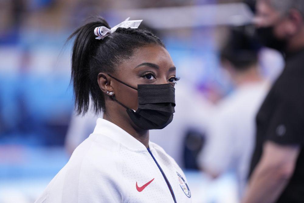 TOKYO, JAPAN - JULY 27: Simone Biles of Team United States looks on duri...