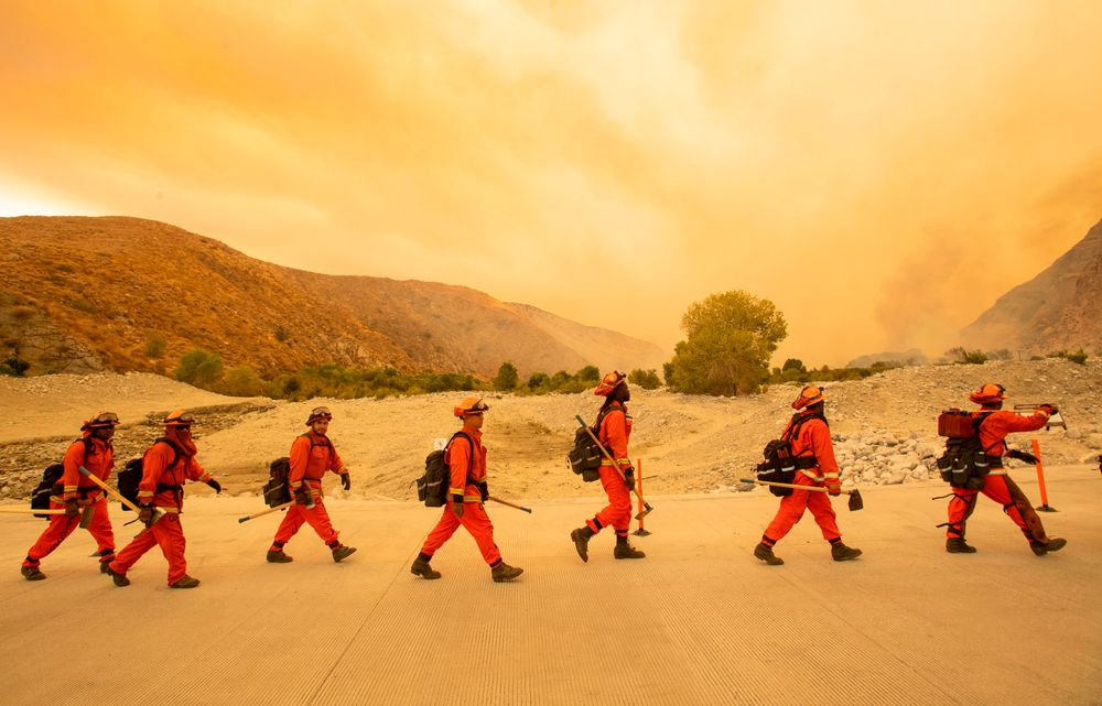TOPSHOT - Inmate firefighters arrive at the scene of the Water fire, a n...