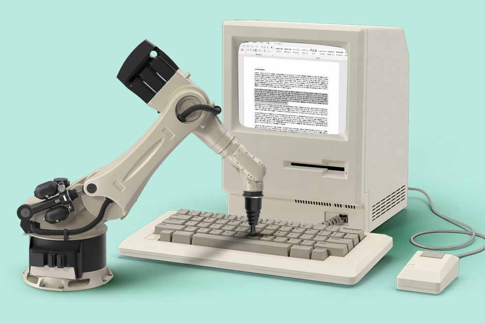 Robot typing on a computer