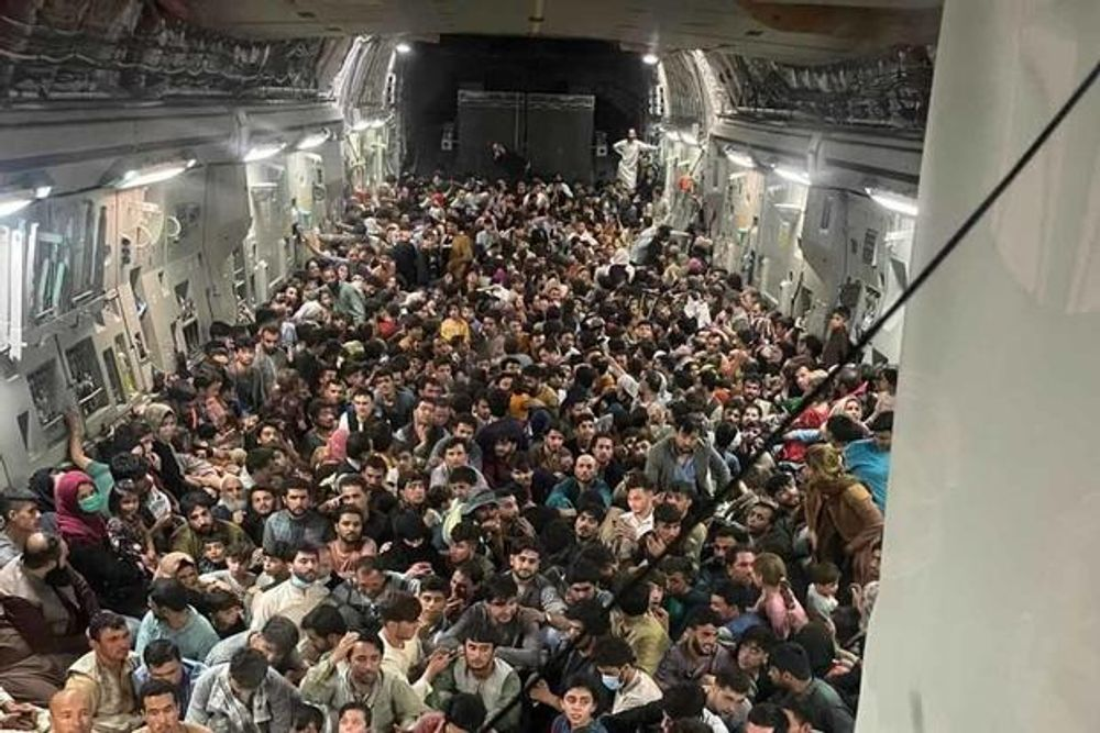 Evacuation of Afghan citizens in a C-17 cargo plane