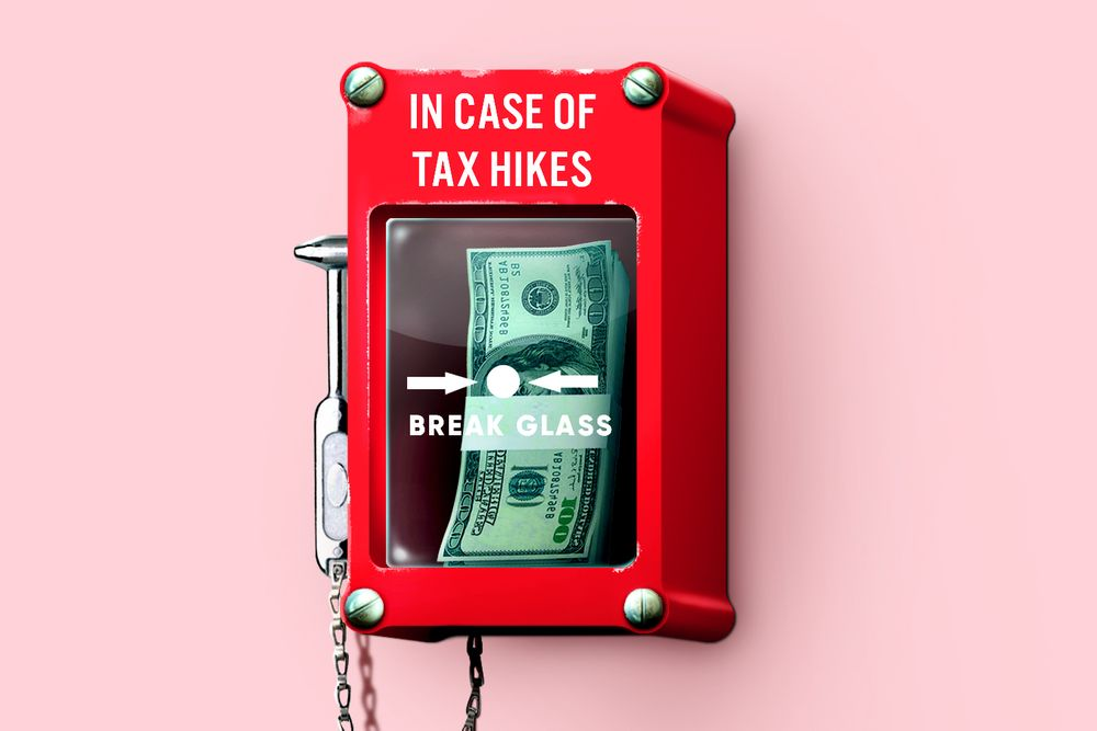 """Old fire extinguisher box that says """"In Case of Tax Hikes, Break Glass"""" with wad of cash inside"""