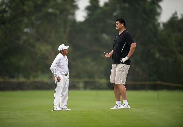 Yao Ming and Gary Player