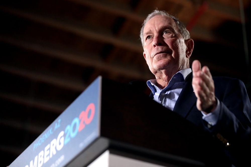 Mike Bloomberg speaks at a podium in presidential campaign