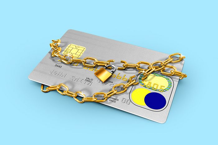 Credit card with a broken lock to suggest consumer confidence rose