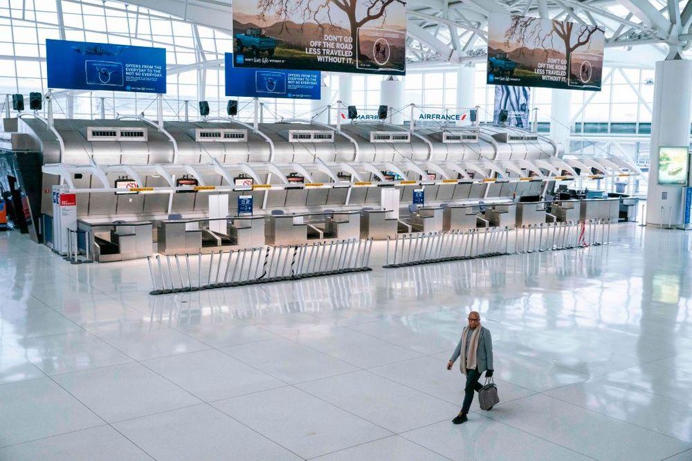 A man walks through an empty airport terminal
