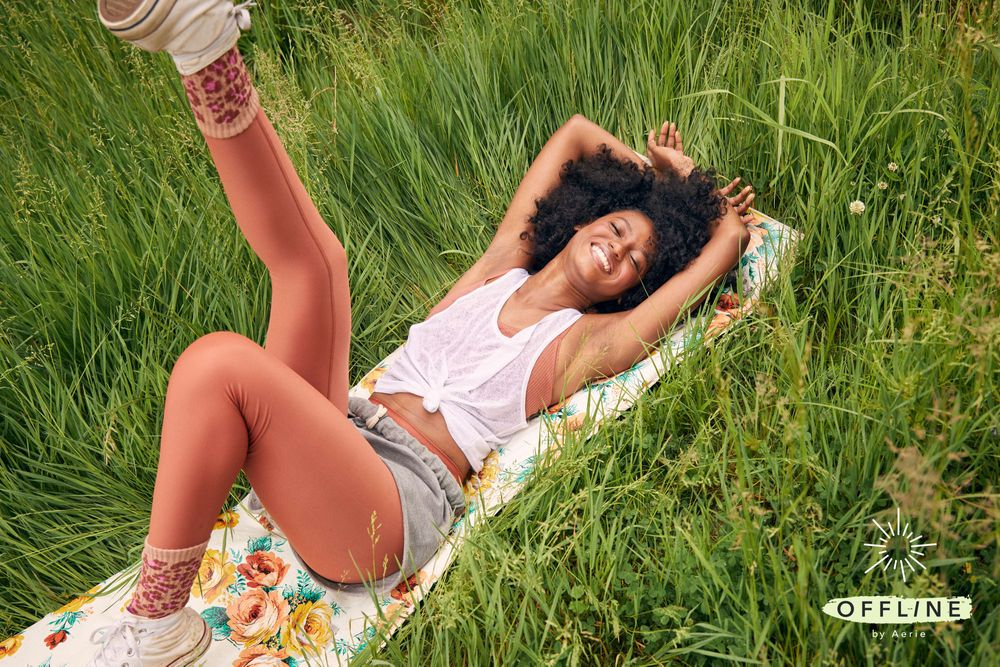 Aerie Offline Brand image showing model wearing Aerie Offline clothing in a field