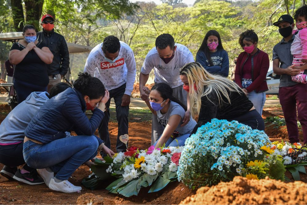 A family mourns Maria Joana Mascimento outside Sao Paulo