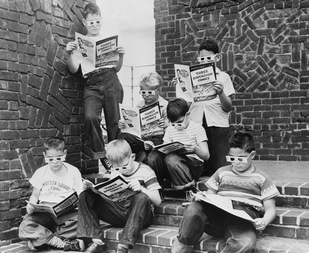 A group of boys read 3-D comic books at the Madison Square Boys Club.