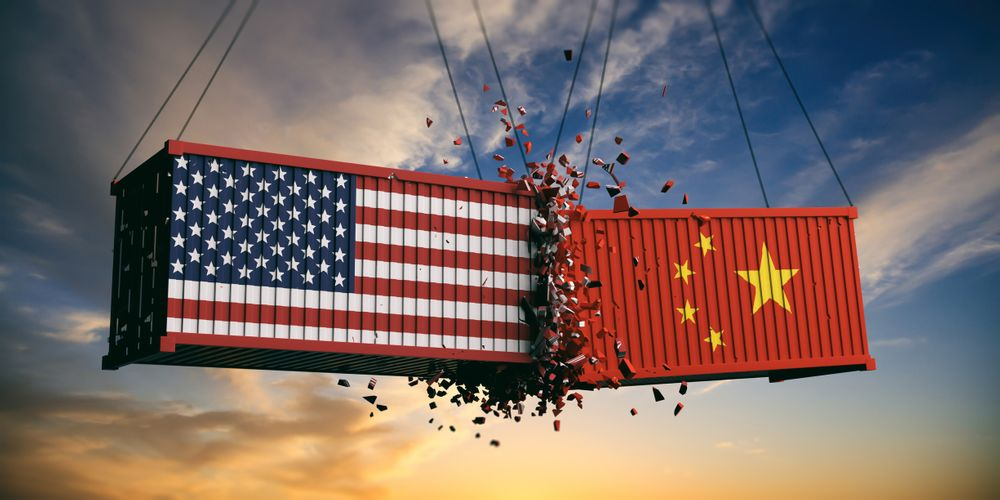 An illustration of two cargo containers colliding; one is painted with the U.S. flag, one with China's