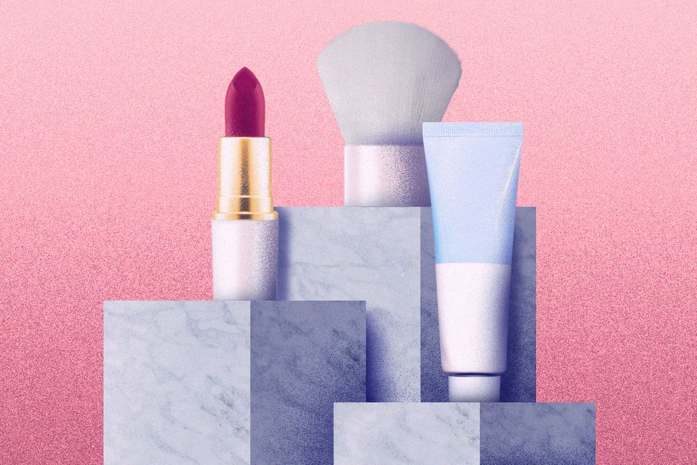 Lip balm, lipstick, and a brush on marble columns
