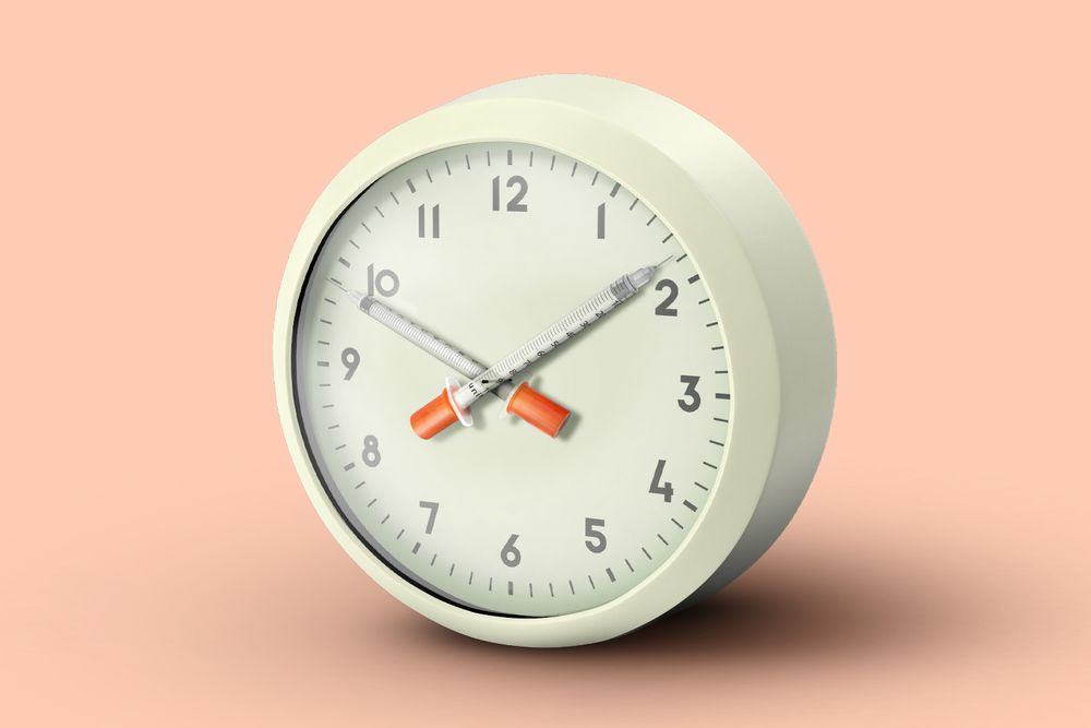A clock with syringes for hands