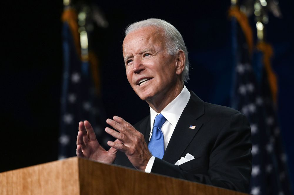 A photograph of Joe Biden speaking at a podium