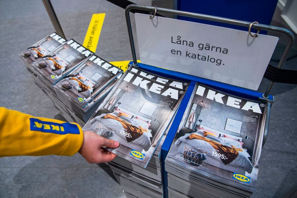 Hand reaching for Ikea catalogs