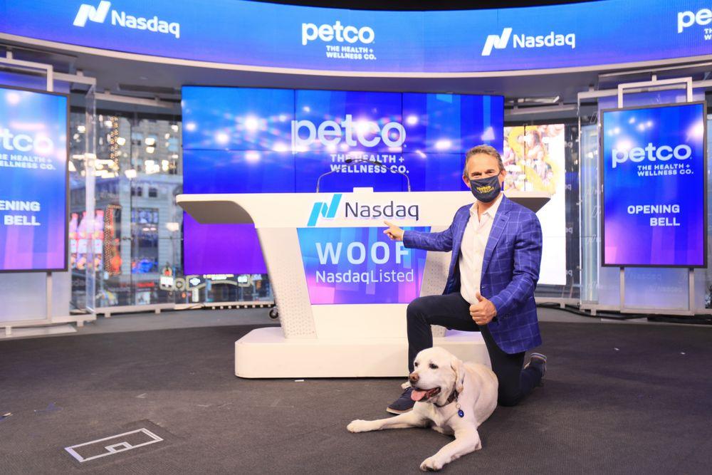 Petco IPO: Petco CEO Ron Coughlin and Yummy the labrador at the Nasdaq