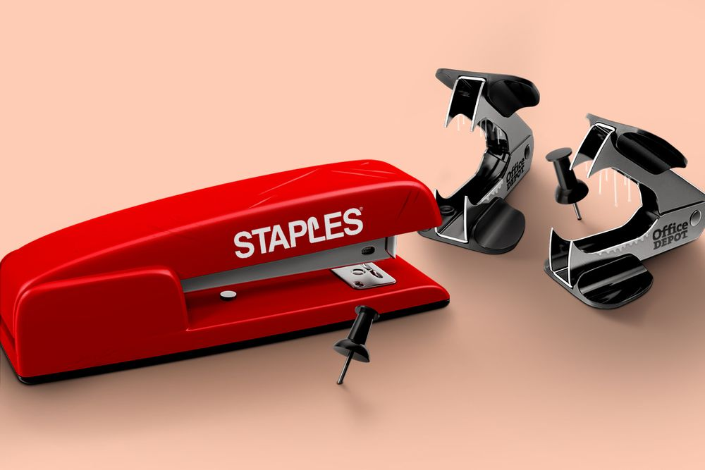 "A stapler and staple removers labeled ""Staples"" and ""Office Depot"""