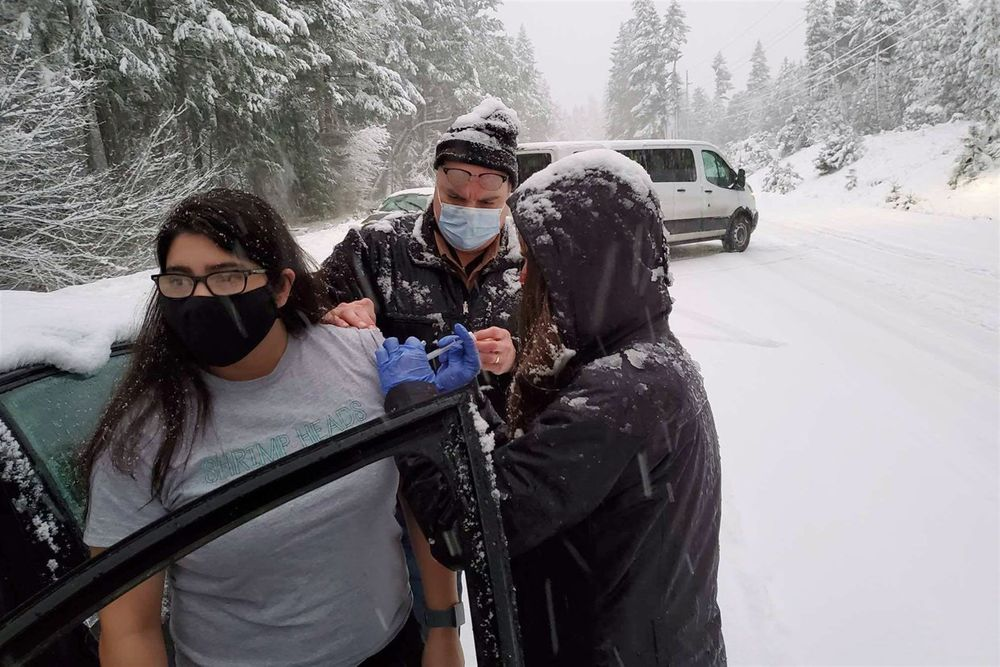 People getting vaccinated on a snowy road