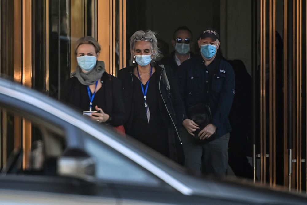 Thea Fischer, Marion Koopmans, Peter Daszak and other members of the World Health Organization (WHO) team investigating the origins of the Covid-19 pandemic, leave the Hilton Wuhan Optics Valley Hotel where the team is currently based post-quarantine in Wuhan.